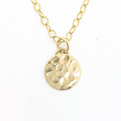 detail view of 14k Gold Filled Hammered Mini Circle Necklace by Judie Raiford