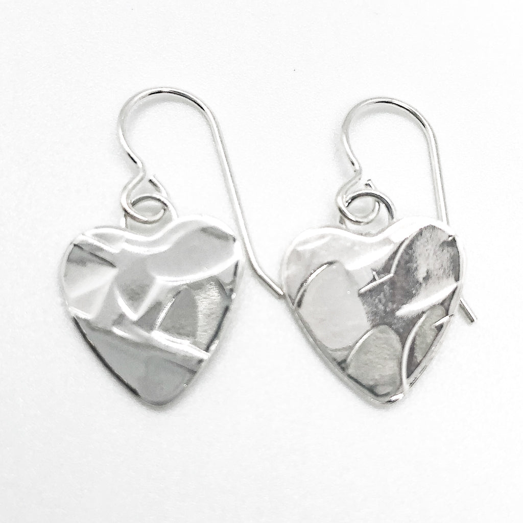 flat lay view of Sterling Silver Small Hammered Heart Earrings by Judie Raiford