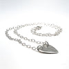 side angle view of sterling silver Stationary Heart Layering Necklace by Judie Raiford