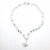 Sterling Irina Necklace with white coin pearl and white baroque pearl by Judie Raiford