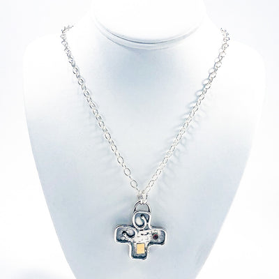 Big Honker Cross Necklace by Judie Raiford on white jewelry display bust