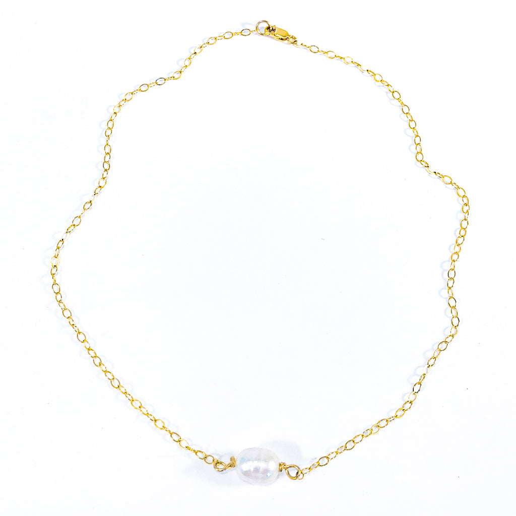 Flat Lay view of White Baroque Pearl on 14k Gold Chain Necklace by Judie Raiford