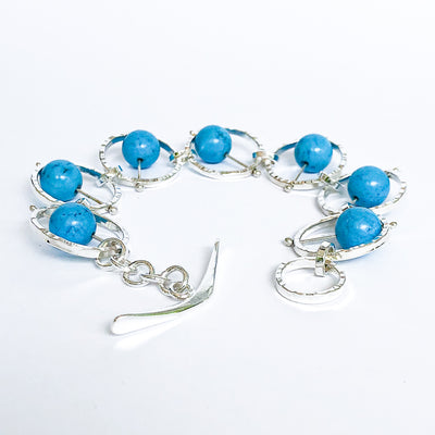 Side Curl  view of Not Naught Round Sterling Bracelet with Turquoise by Judie Raiford