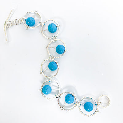 Flat Lay view of Not Naught Round Sterling Bracelet with Turquoise by Judie Raiford