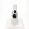 Sterling Wrap Ring with Black Onyx by Judie Raiford on white finger stand