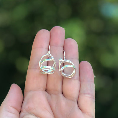 held in hand view of Sterling Curly Girl Earrings by Judie Raiford