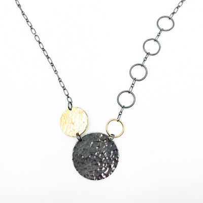 pendant detail view of Oxidized Sterling and 14k Gold Fill Hammered Circles Necklace by Judie Raiford