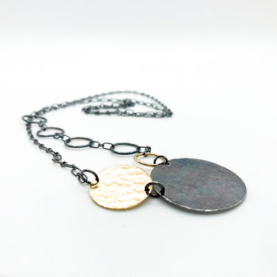 side angle view of Oxidized Sterling and 14k Gold Fill Hammered Circles Necklace by Judie Raiford