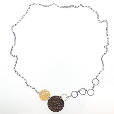 flat lay view of Oxidized Sterling and 14k Gold Fill Hammered Circles Necklace by Judie Raiford