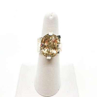 size 7 Big Honker Lynne Ring with Faceted Citrine by Judie Raiford on white ring display stand
