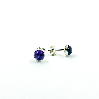 side angle view of 6mm Amethyst Cabochon Stud Earrings by Judie Raiford
