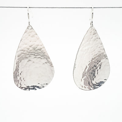 sterling silver Sinclastic Pear Shaped Earrings by Judie Raiford hanging on wire