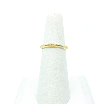 14k Gold Filled Hammered Stack Ring by Judie Raiford displayed on white ring stand