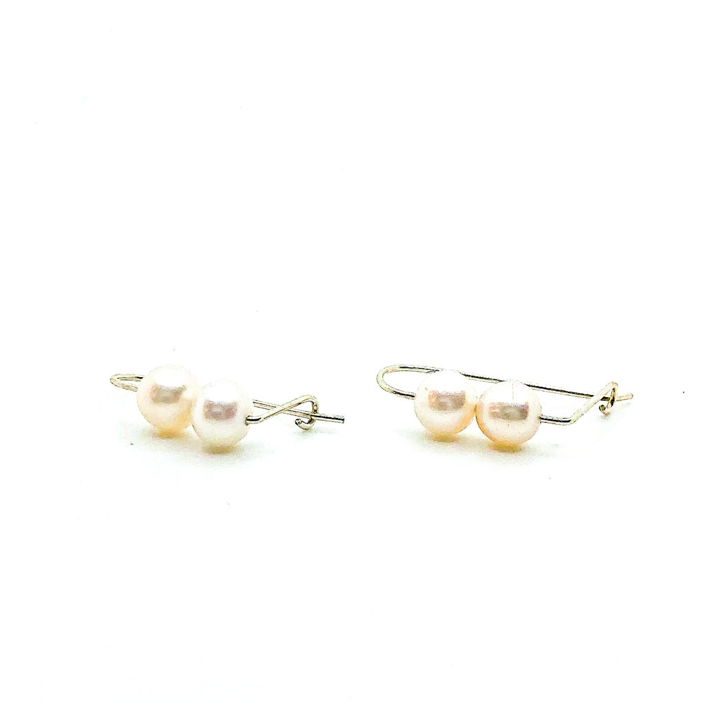 side angle view of Sterling Two Pearl Earrings by Judie Raiford