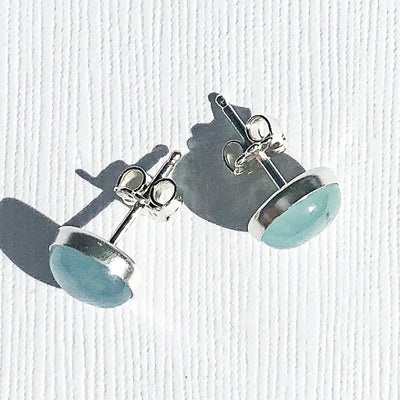 overhead view of Aquamarine Cabochon Stud Earrings by Judie Raiford
