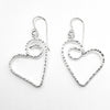 flat lay view of Sterling Silver Small Curly Jane Heart Textured Earrings by Judie Raiford