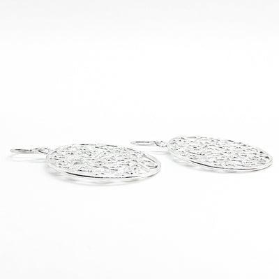 side angle view of sterling silver Stella Earrings by Judie Raiford
