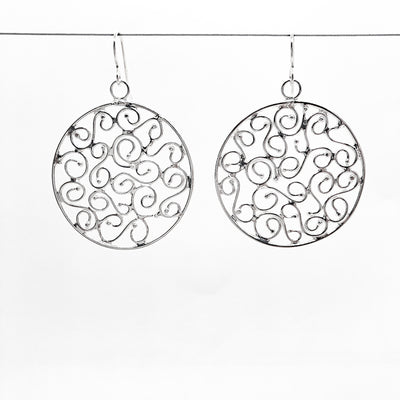 sterling silver Stella Earrings by Judie Raiford hanging on wire