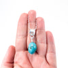 sterling silver Big Juicy Stone Necklace with Turquoise by Judie Raiford held in hand