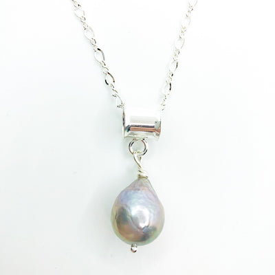 detail view of Big Juicy Pearl Necklace with Gray Baroque Pearl by Judie Raiford