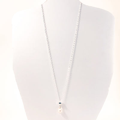 Big Juicy Pearl Necklace with White Baroque Pearl by Judie Raiford hanging on white mannequin cut out