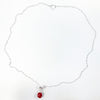 flat lay view of sterling silver Big Juicy Stone Necklace with Red Coral by Judie Raiford