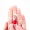sterling silver Big Juicy Stone Necklace with Red Coral by Judie Raiford held in hand