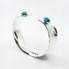 side angle view of Sterling Anticlastic Cuff with Turquoise by Judie Raiford