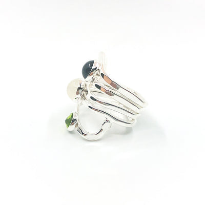 left side view of size 6.75 Sterling Wrap Ring with London Blue Topaz, Moonstone, and Peridot by Judie Raiford