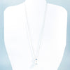 White Baroque Pearl on Sterling Long Short Chain by Judie Raiford on white mannequin display bust