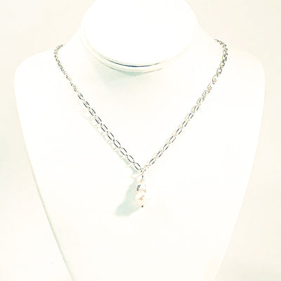 White Baroque Pearl on Sterling Long Short Chain by Judie Raiford on white jewelry display bust