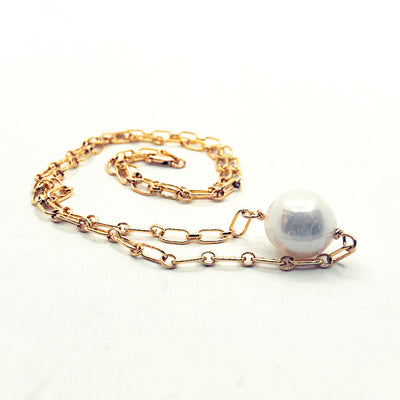 side angle view of Single White Pearl on 14k Gold Filled Long Short Chain by Judie Raiford