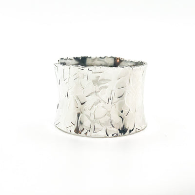 side view of Sterling and 24k MB3 Anticlastic Cuff by Judie Raiford