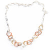 flat lay of Five Metal Necklace by Judie Raiford