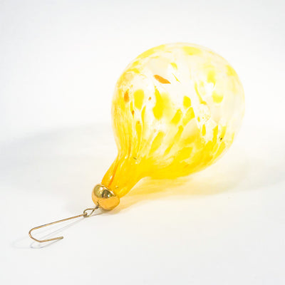 side angle view of Yellow Glass Ornament by Neal Drobnis