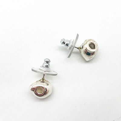 over top view of sterling silver Olive Post Earrings by Betsy Frost