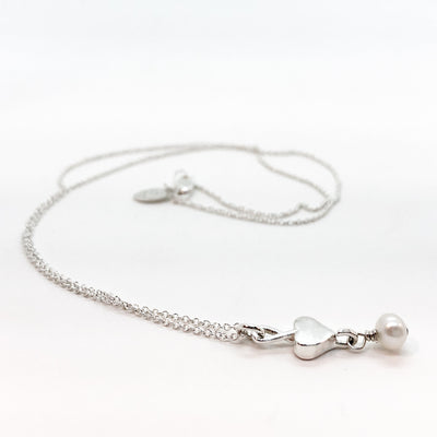 side angle view of sterling Sweetheart Necklace with Freshwater Pearl by Betsy Frost