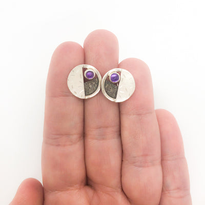 sterling silver, oxidized sterling, Amethyst Circle Co Post Earrings by Donna Burdic held in hand