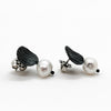 side angle view of oxidized sterling Oval with Pearl Post Earrings by Donna Burdic
