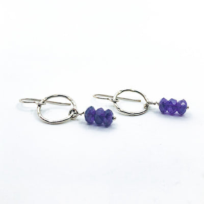 side angle view of Sterling Circle Drop Earrings with Amethyst by Berlin Randall