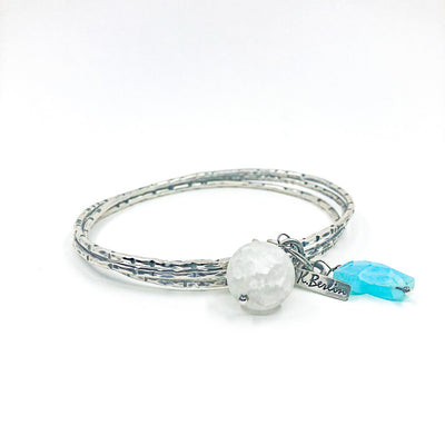side angle view of Triple Bangle with Frosted Quartz and Peruvian Blue Opal by Berlin Randall