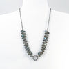 Oxidized Sterling Labradorite Bead Necklace with Textured Circle Pendant on white mannequin display bust