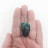 Oxidized Sterling Necklace with Azurite Chrysocolla Pendant by Berlin Randall held in hand