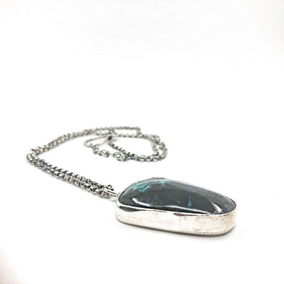 side angle view of Oxidized Sterling Necklace with Azurite Chrysocolla Pendant by Berlin Randall