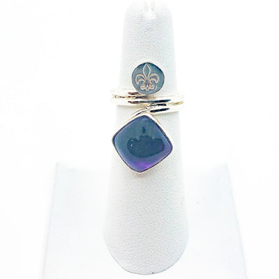size 4.75 Sterling Wrap Ring with Amethyst and Fleur de Lis by Berlin Randall on white ring display stand