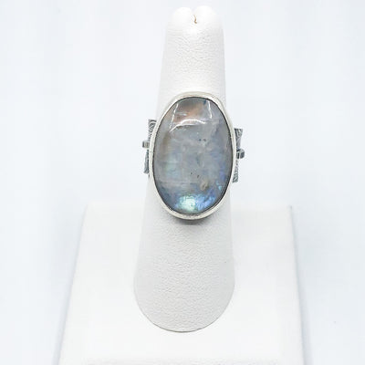 size 7.5 Sterling Oval Rainbow Moonstone Ring by Berlin Randall on white ring display stand