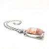 side angle view of Sterling Cherry Quartz Mandala Necklace by Berlin Randall