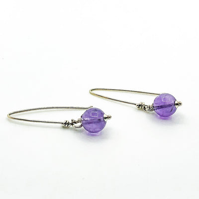 side angle view of Sterling Allure Earrings with Amethyst by Berlin Randall
