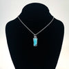 Sterling Opalized Wood Pendant Necklace by Berlin Randall displayed in a black mannequin jewelry display bust