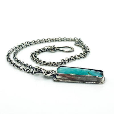 side angle view of Sterling Opalized Wood Pendant Necklace by Berlin Randall